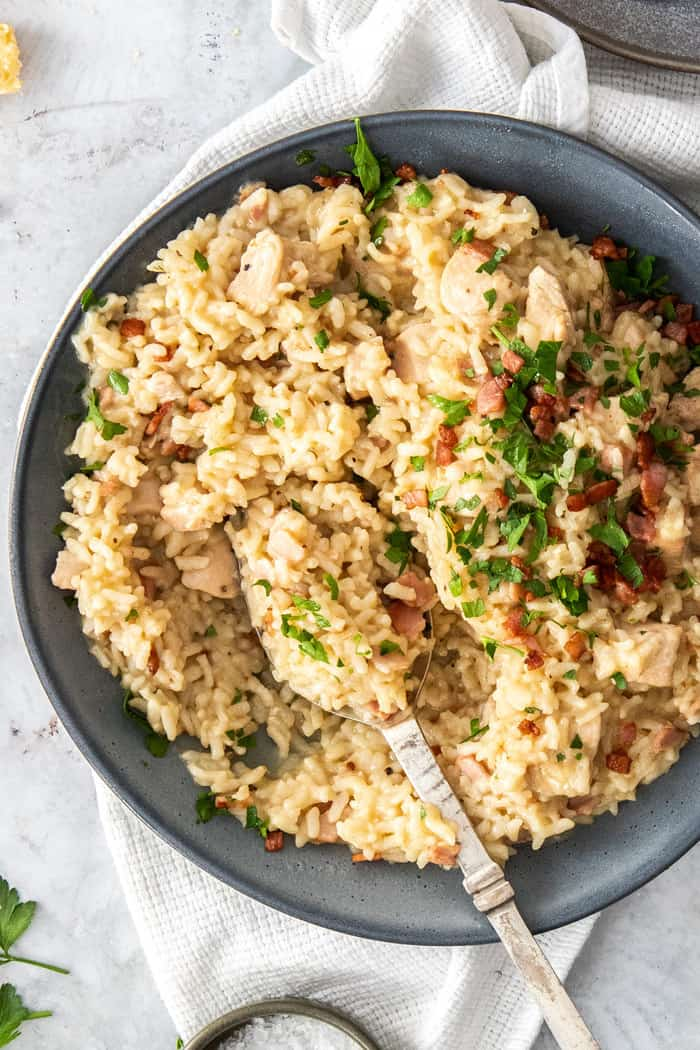 a bowl of instant pot risotto topped with parsley