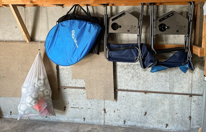 soccer items hanging on a wall in a garage