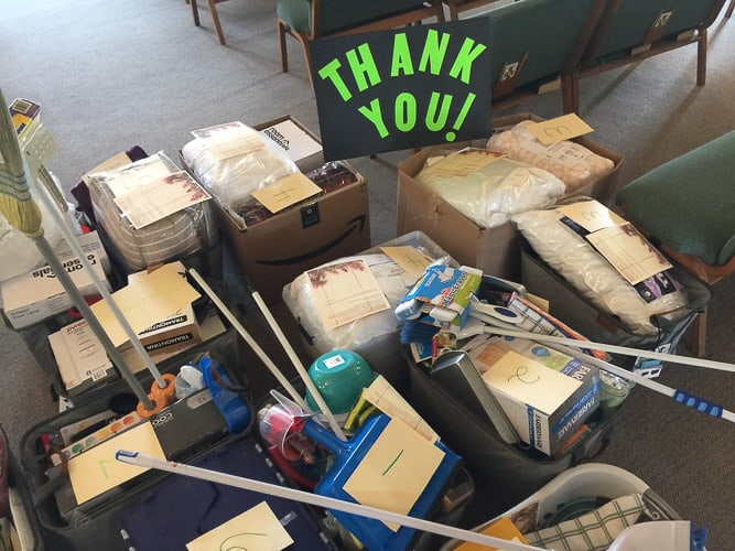 boxes with household items on a church floor
