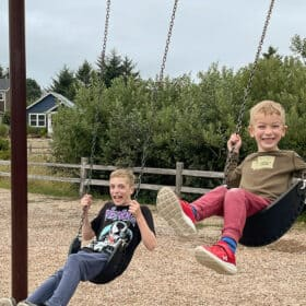 two boys on a swing