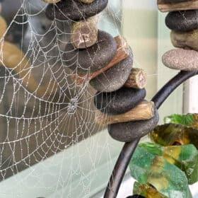 spider webs on a rock sculpture