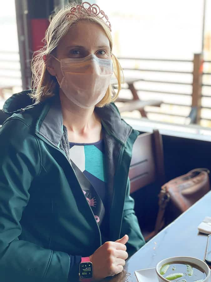 a woman in a coat in a restaurant