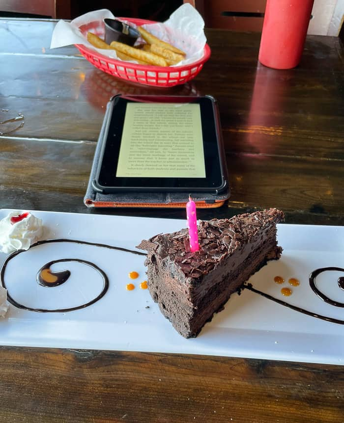 cake on a plate with a kindle