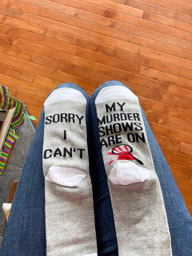 """two socks - 1 says """"Sorry I can't"""" and the other says """"my murder shows are on"""""""