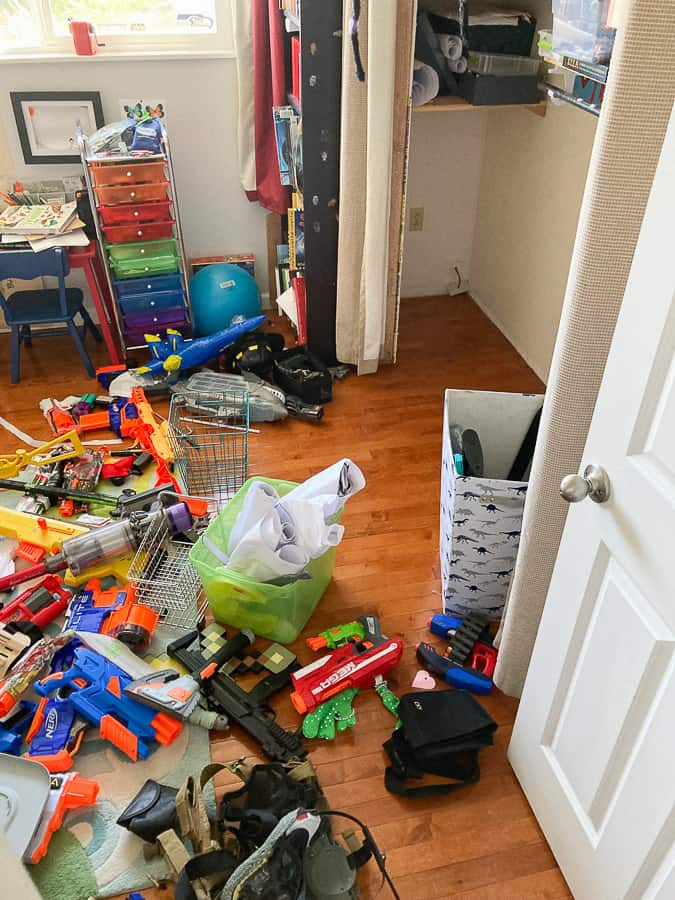 lots of toys on a bedroom floor