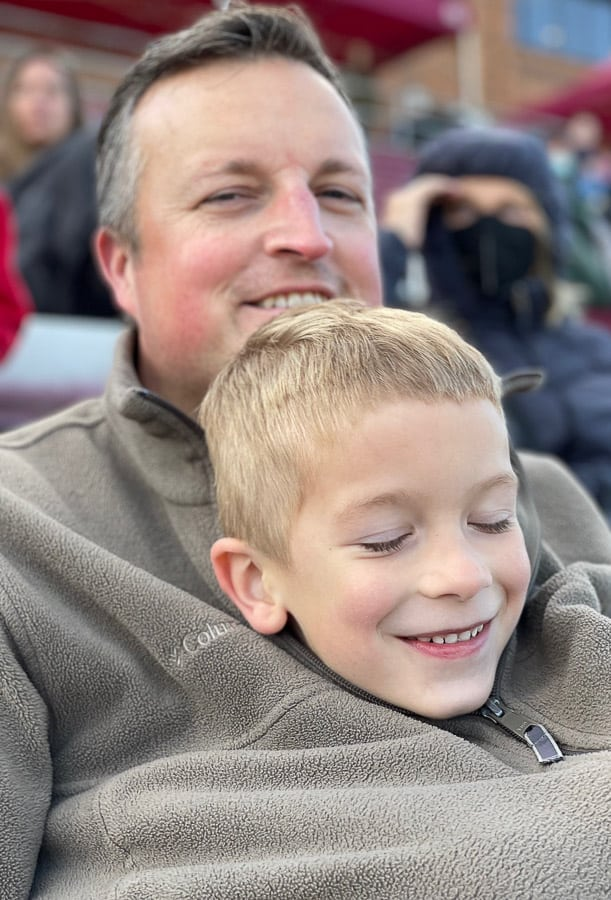 a boy in his dad's fleece