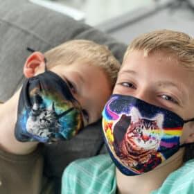 2 boys wearing cat masks